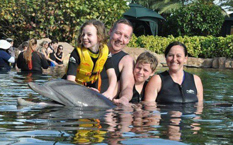 Picture of Abigail with Dolphins